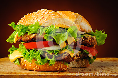 bitten-hamburger-fast-food-big-delicious-cheeseburger-33671242